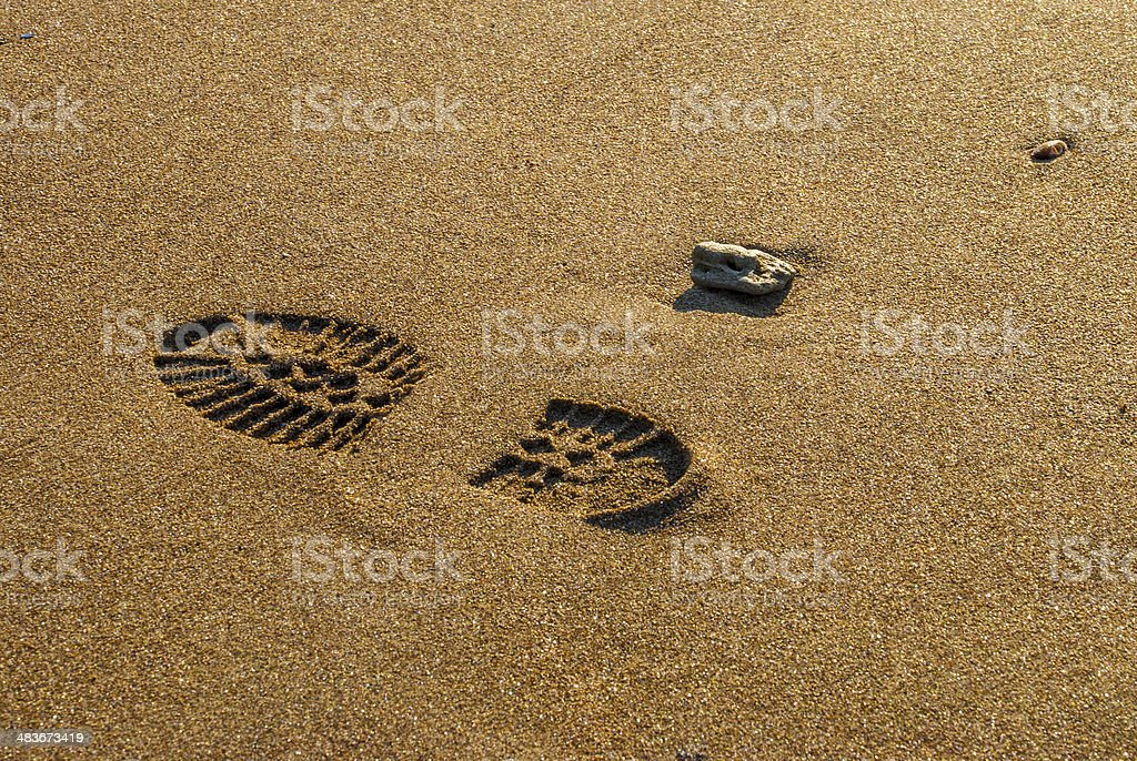 single boot print on the beach stock photo