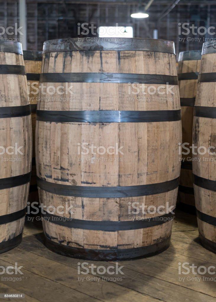 Single Bourbon Barrel in Storage stock photo