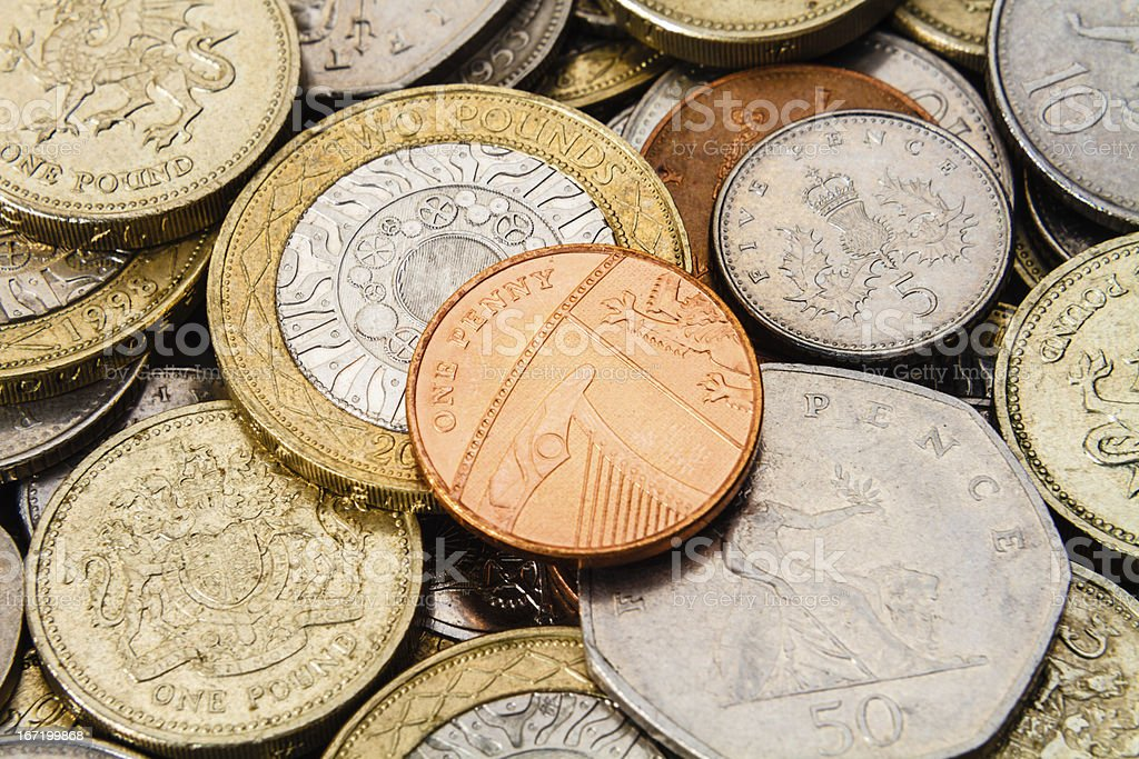 Single British Penny on Top of GBP Coins stock photo