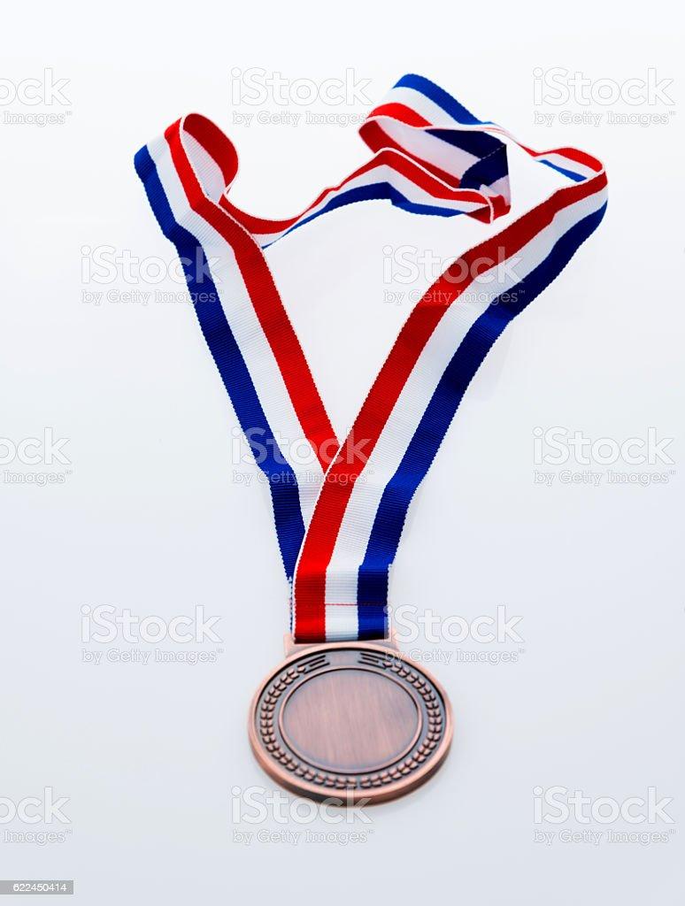 Single bronze medal isolated on white background stock photo