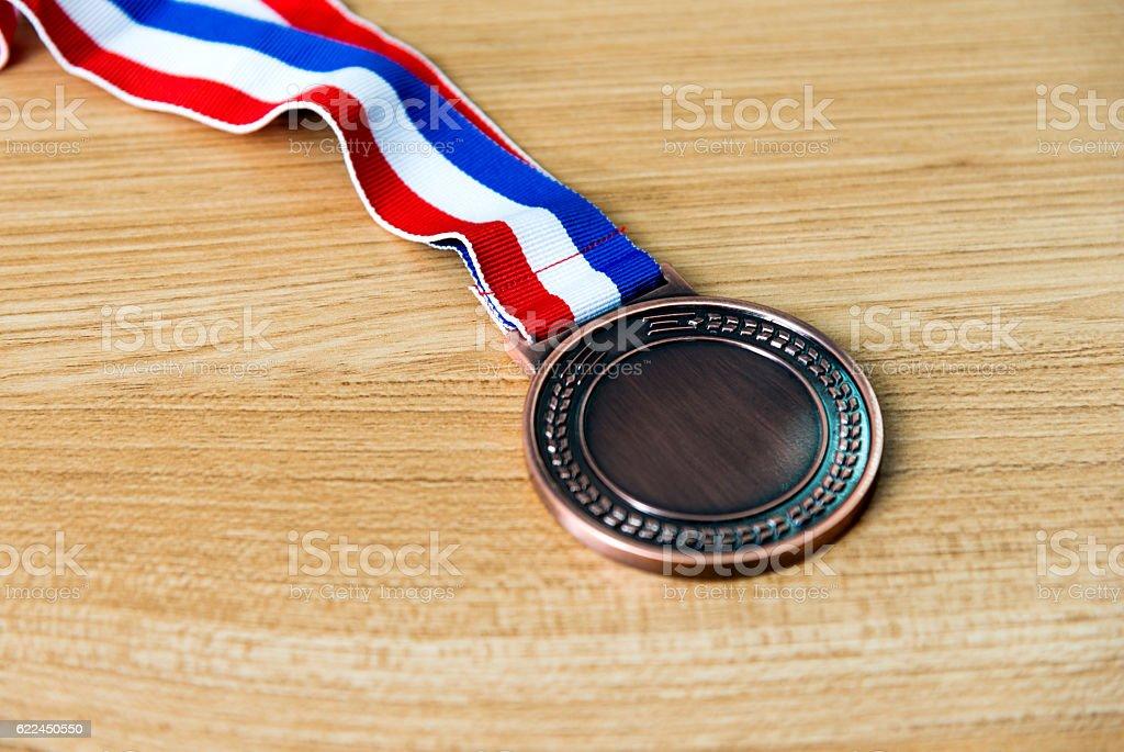 Single bronze medal on wood desk stock photo