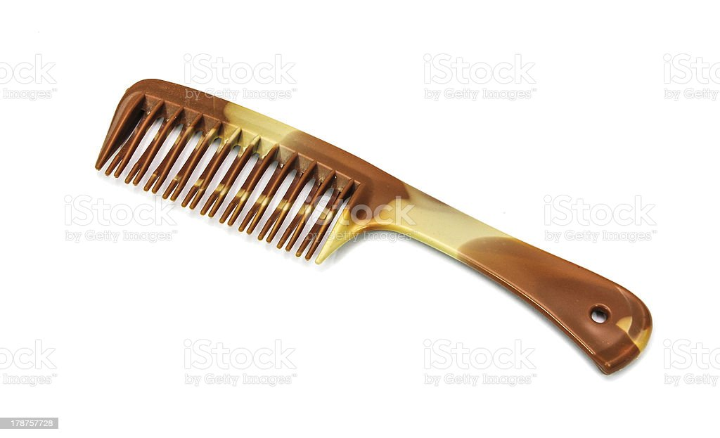 single brown comb at the white background royalty-free stock photo