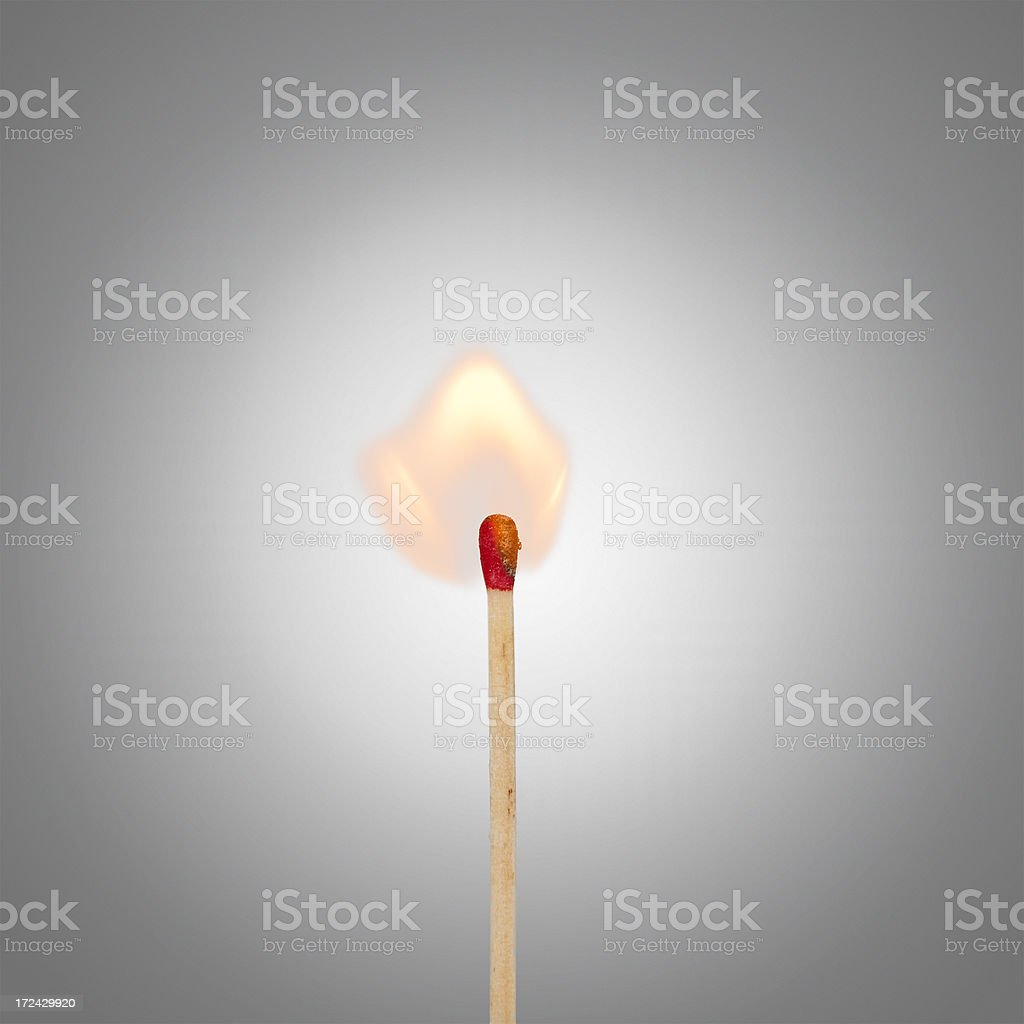 single burning match with graded background - igniting idea concept royalty-free stock photo