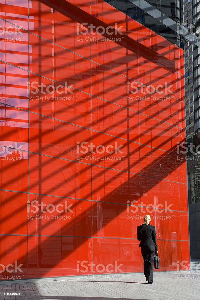 Single Businesswoman In Red Hi Tech City Surrounding royalty-free stock photo