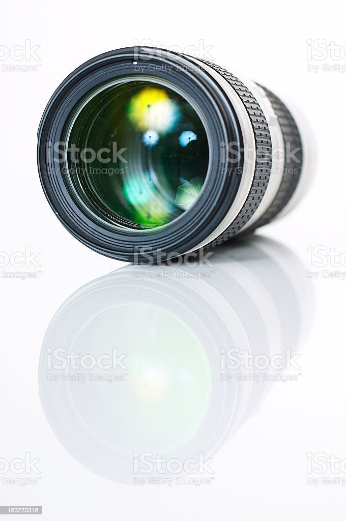 A single camera photo lens reflecting on the surface stock photo
