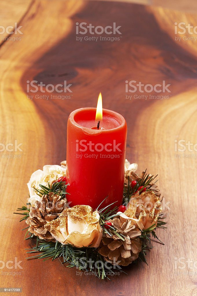 Single candle in a Christmas decoration royalty-free stock photo