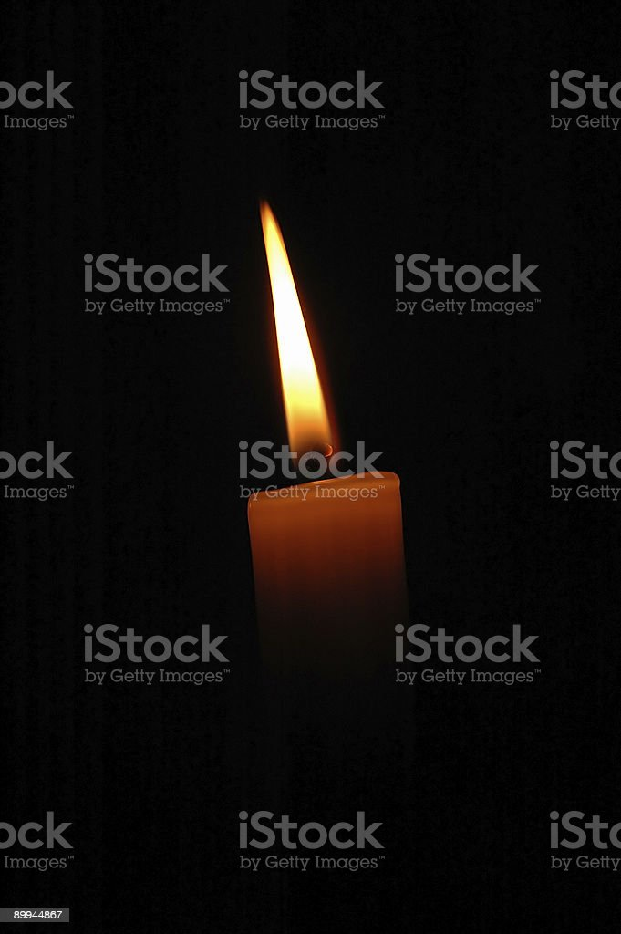 Single candle in the dark royalty-free stock photo