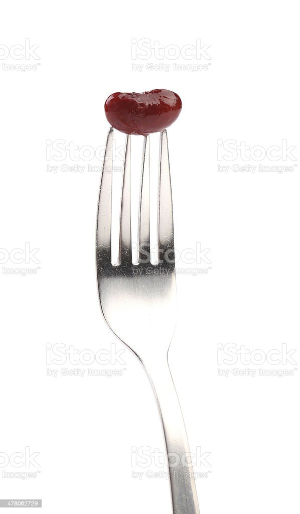Single canned bean on fork. royalty-free stock photo