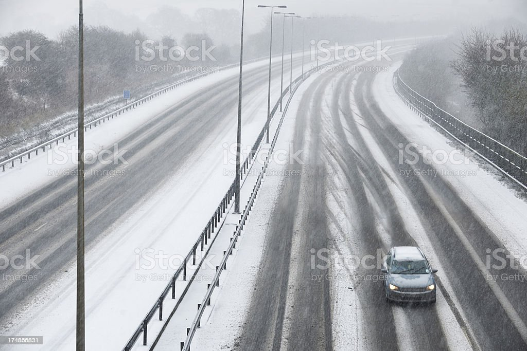 Single Car On Motorway During Snow Storm royalty-free stock photo