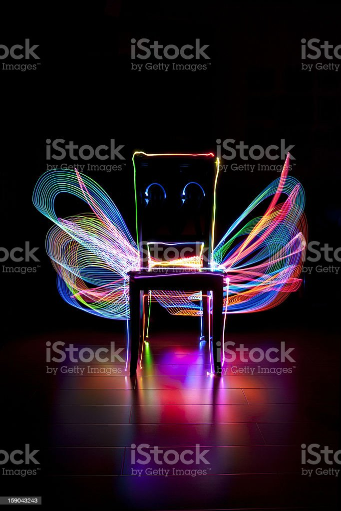 Single chair on back background with colorful abstract stock photo