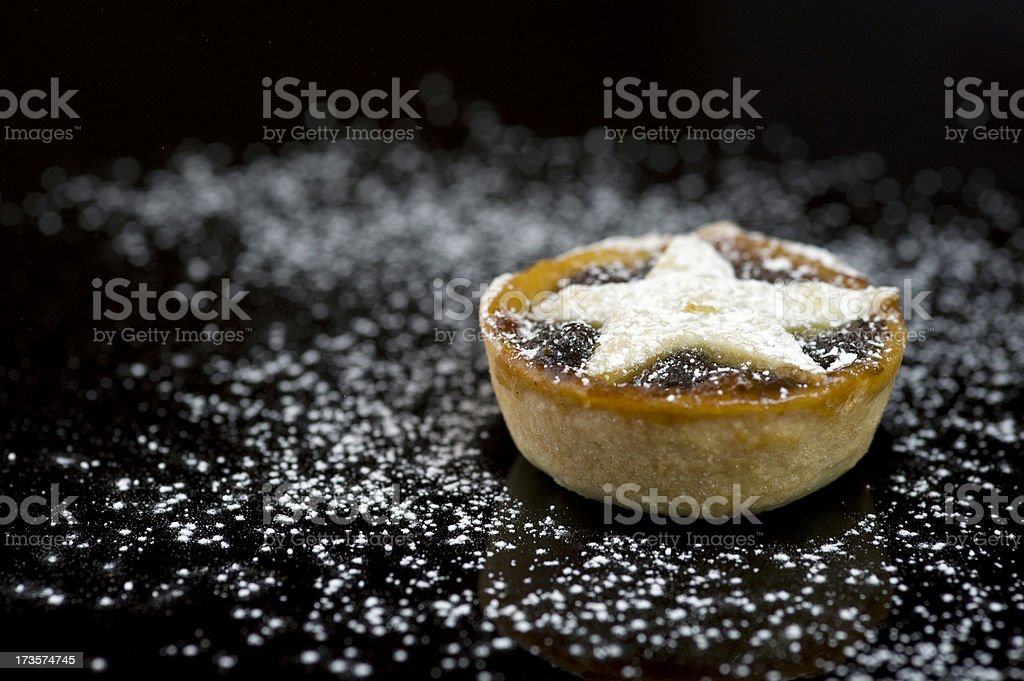 Single christmas mince pie on black background stock photo
