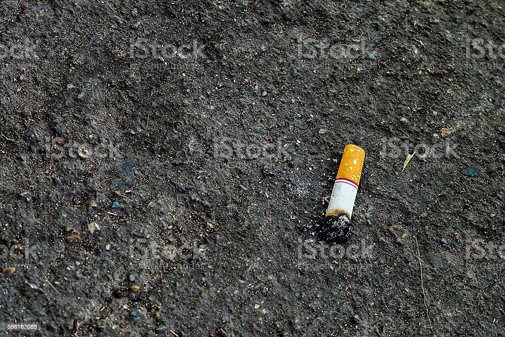 Single cigarette butt with ash stock photo