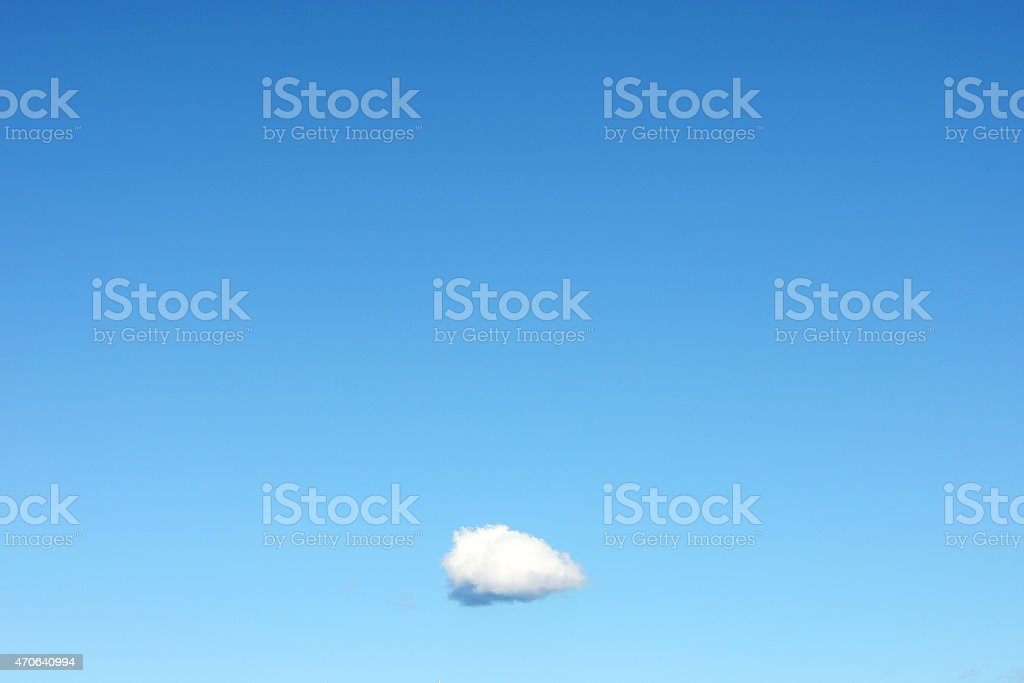 Single Cloud in Clear Blue Sky stock photo