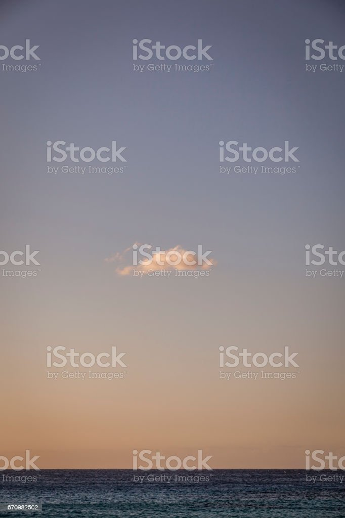 single cloud over the ocean stock photo