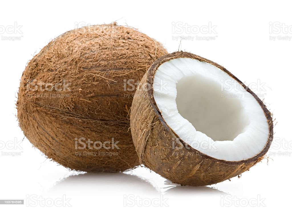 A single cut open coconut sliced open showing insides royalty-free stock photo