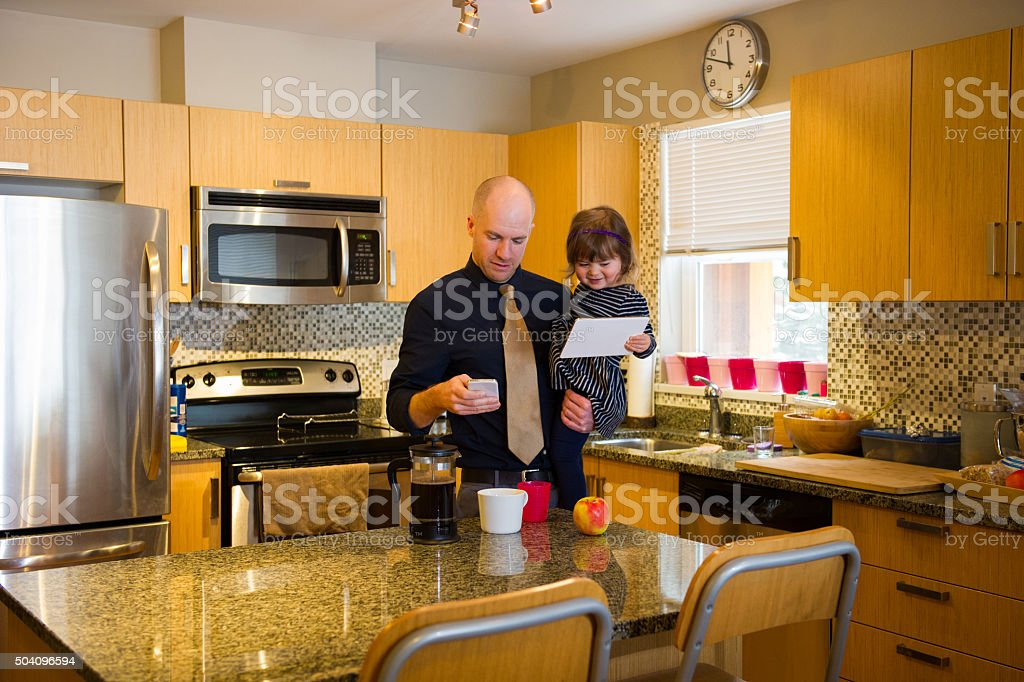 Single Dad getting ready for work stock photo