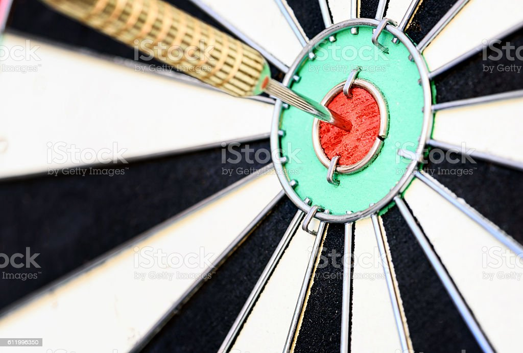 Single Dart Stuck in a Bullseye Board stock photo