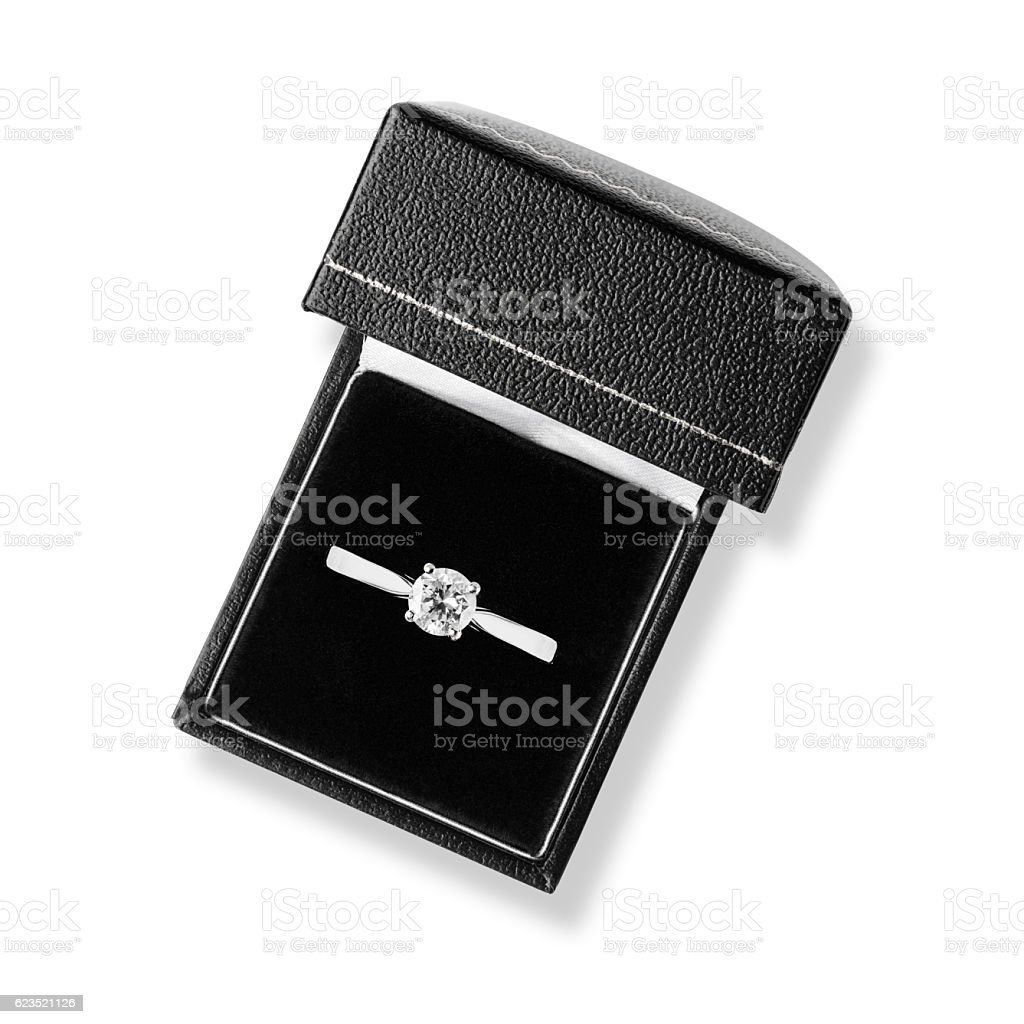 Single diamond solitaire engagement ring in black leather box stock photo