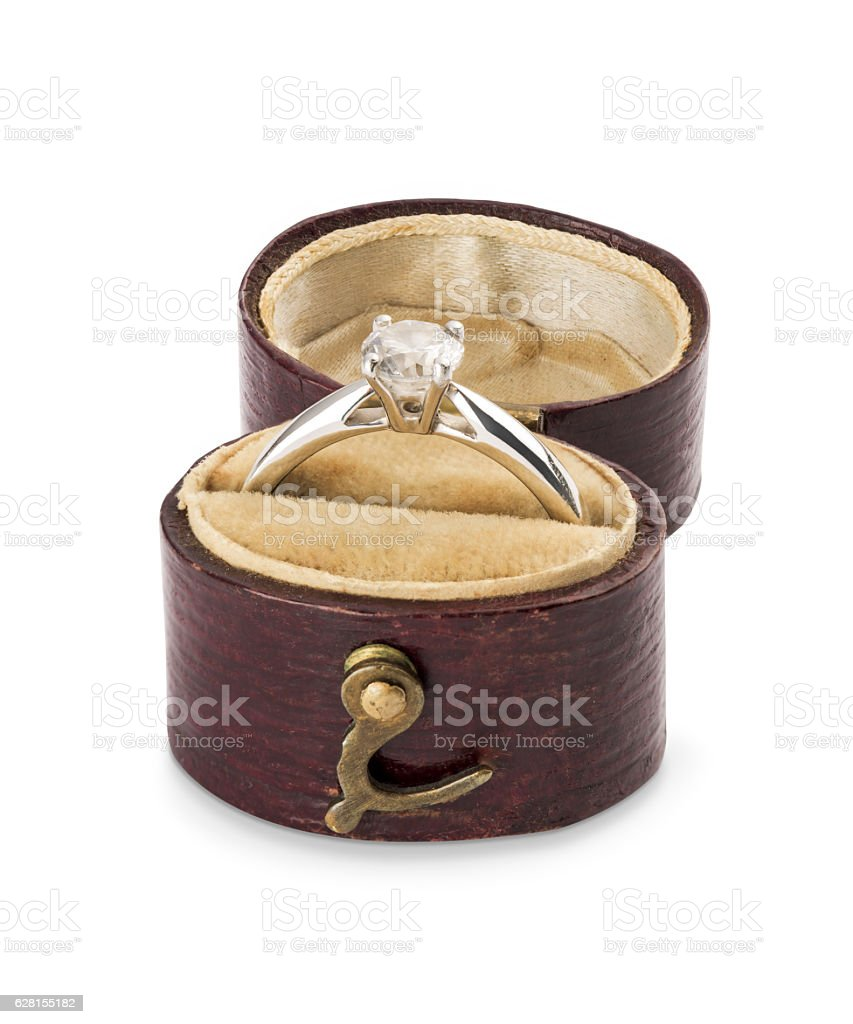 Single diamond solitaire engagement ring in vintage leather burg stock photo