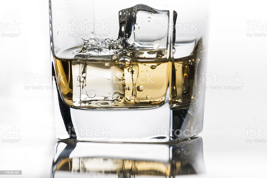 Single drop in whiskey on the rocks royalty-free stock photo