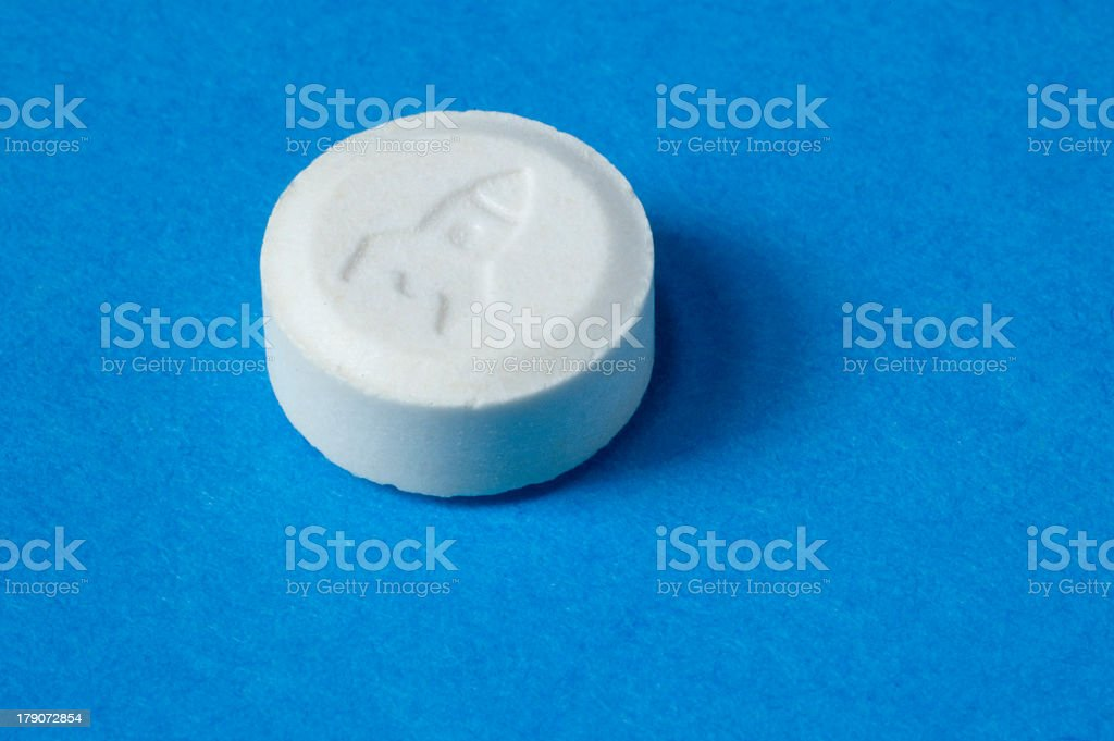 A single ecstasy pill with a rocket design imprinted stock photo