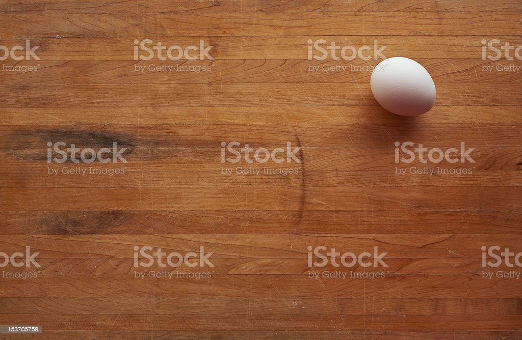 Single Egg on a Butcher Block Countertop royalty-free stock photo