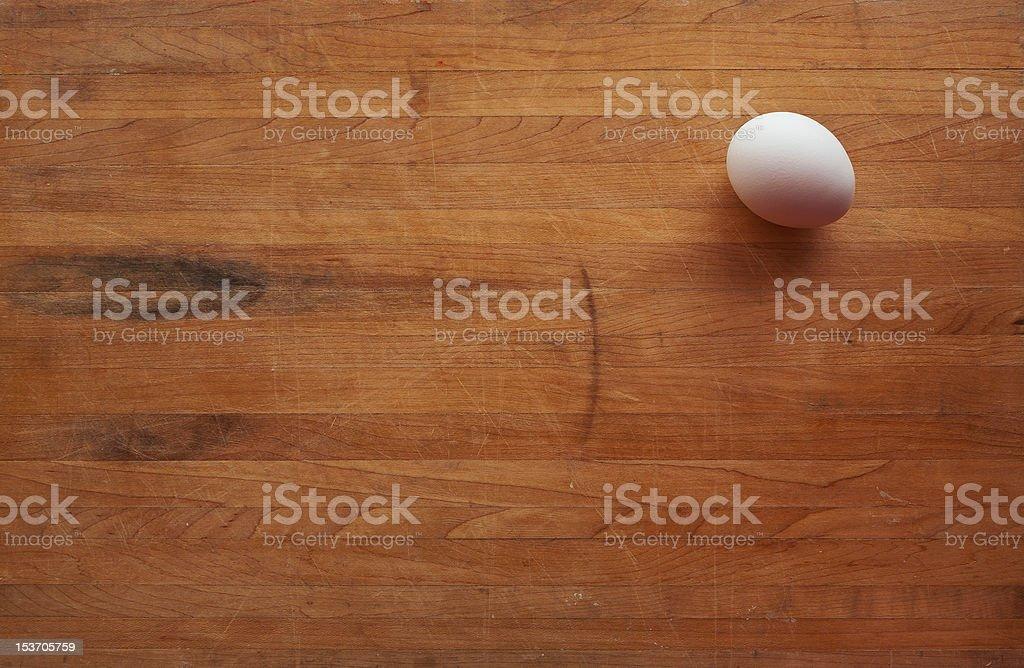 Single Egg on a Butcher Block Countertop stock photo