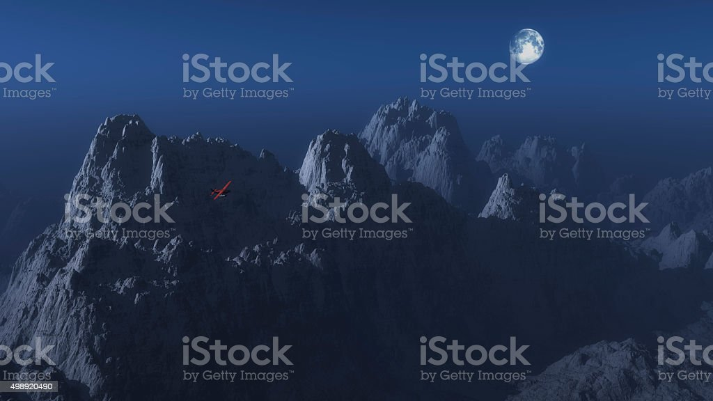 Single engine airplane over winter mountain landscape in moonlight. stock photo