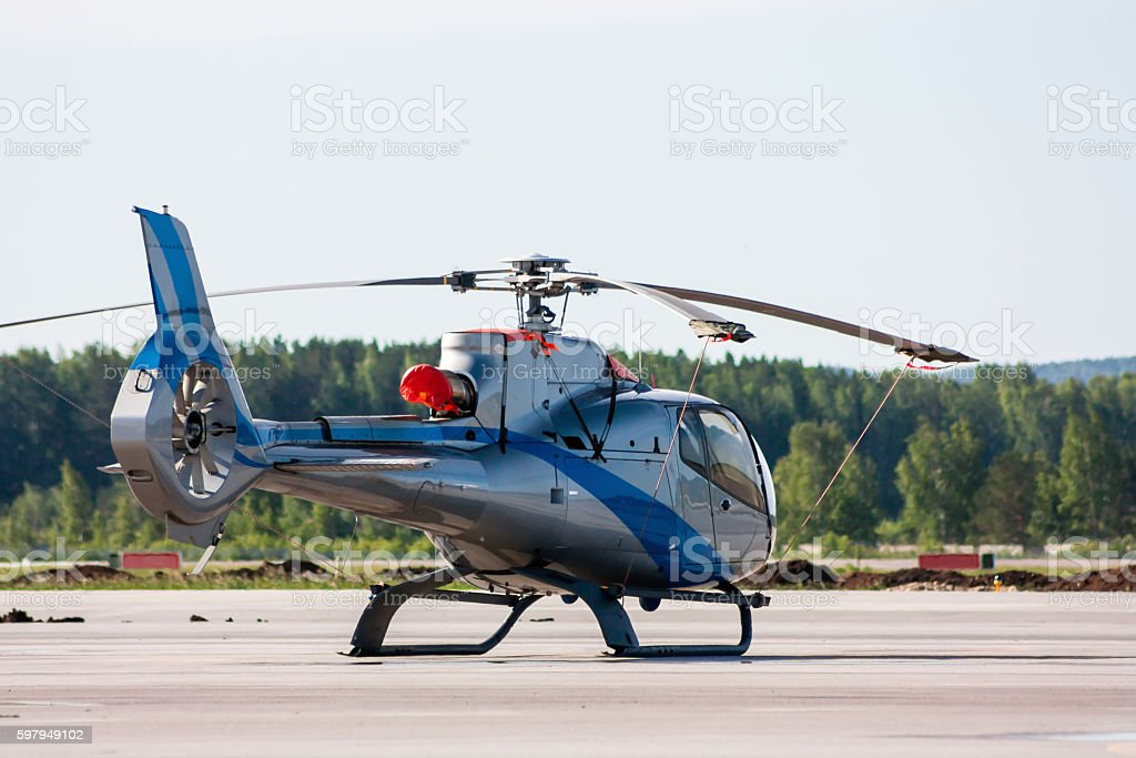 Single engine light helicopter on the airport apron royalty-free stock photo