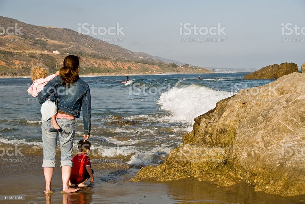 Single family at the beach - People Series stock photo