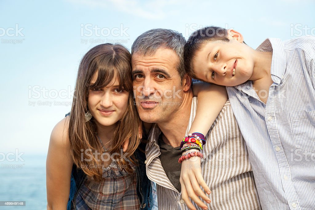 Single father with two kids stock photo