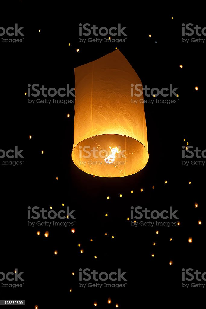 Single Floating Lantern during Firework Festival in Thailand stock photo