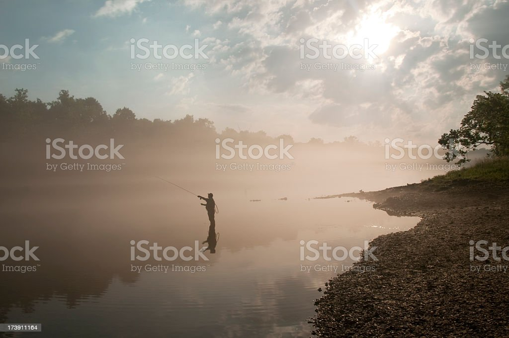 A single fly fisherman out in the morning royalty-free stock photo