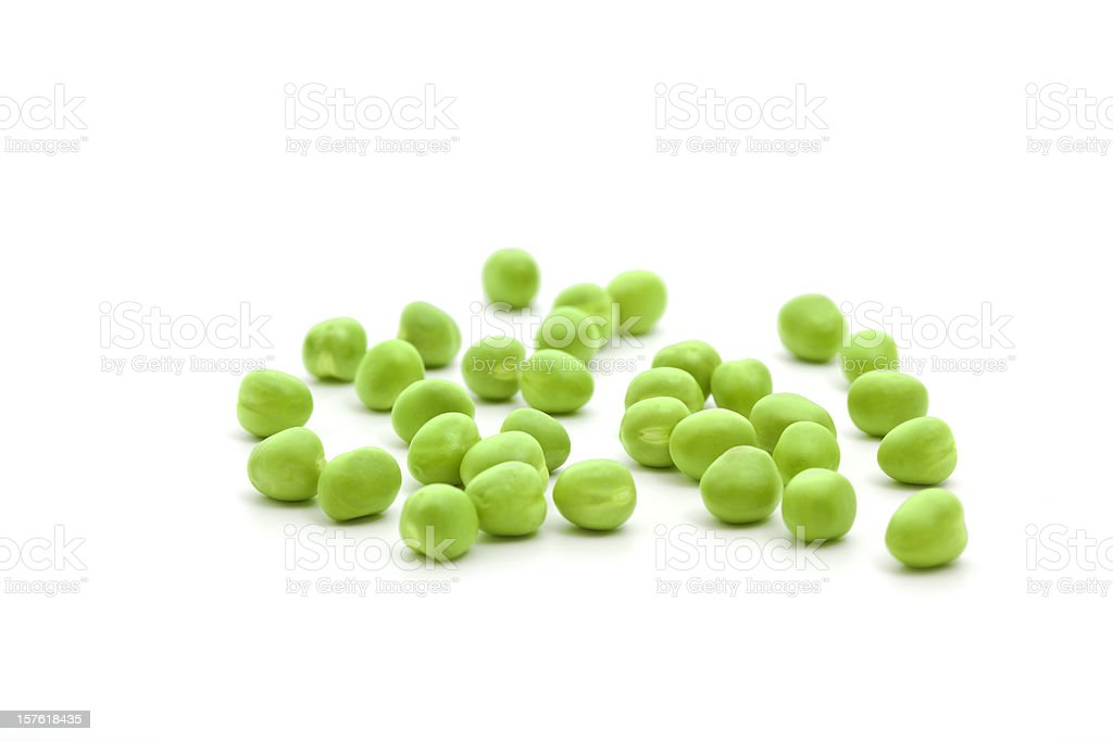 Single fresh green peas isolated on a white background stock photo