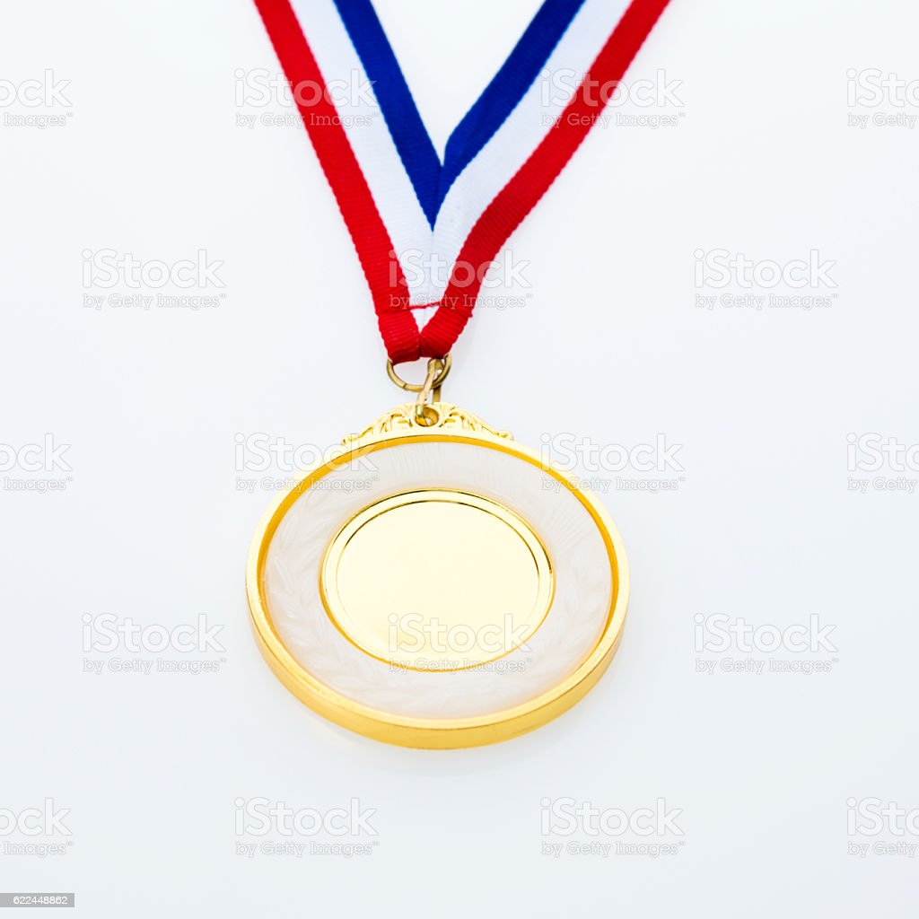 Single gold medal isolated on white background stock photo