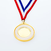 Single gold medal isolated on white background