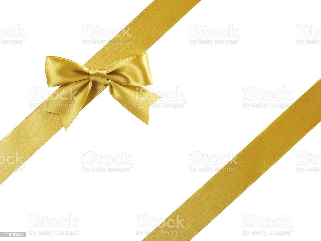 single golden satin gift bow with oblique ribbon on white stock photo