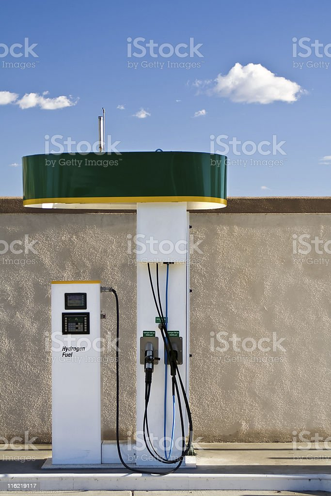 Single green and white hydrogen fuel pump on a sunny day stock photo