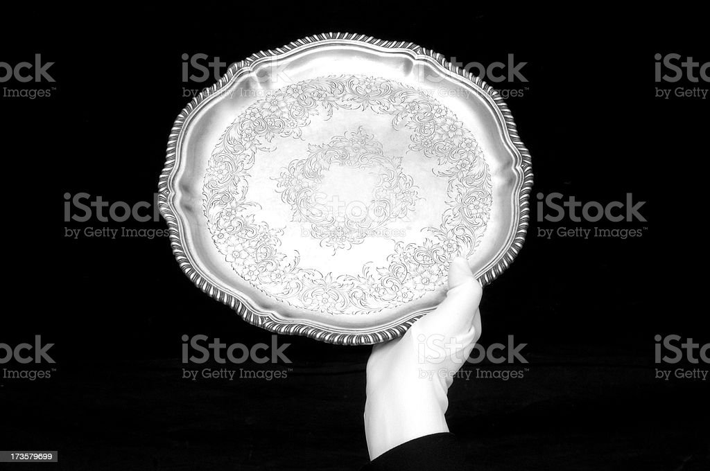 Single hand silver tray presentation stock photo