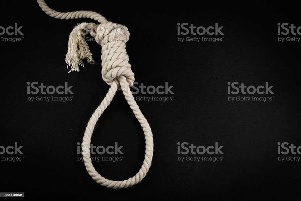 Single Hangmans Noose in White Rope on Black stock photo