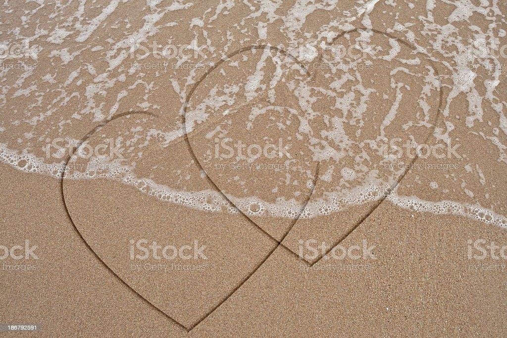 Single heart hand draw on sand royalty-free stock photo