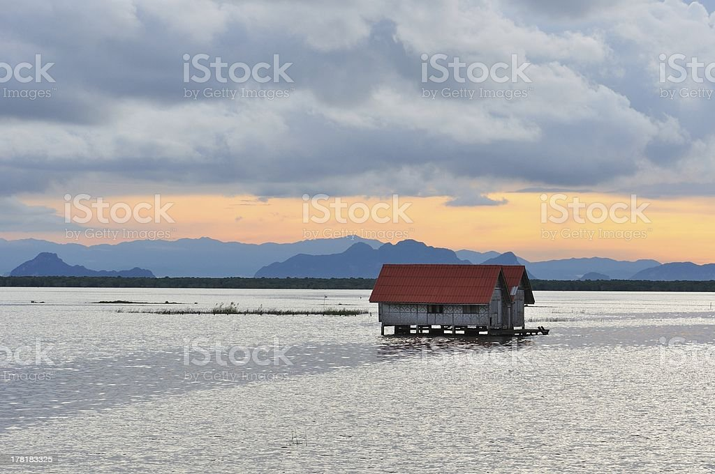 Single house in the sea royalty-free stock photo