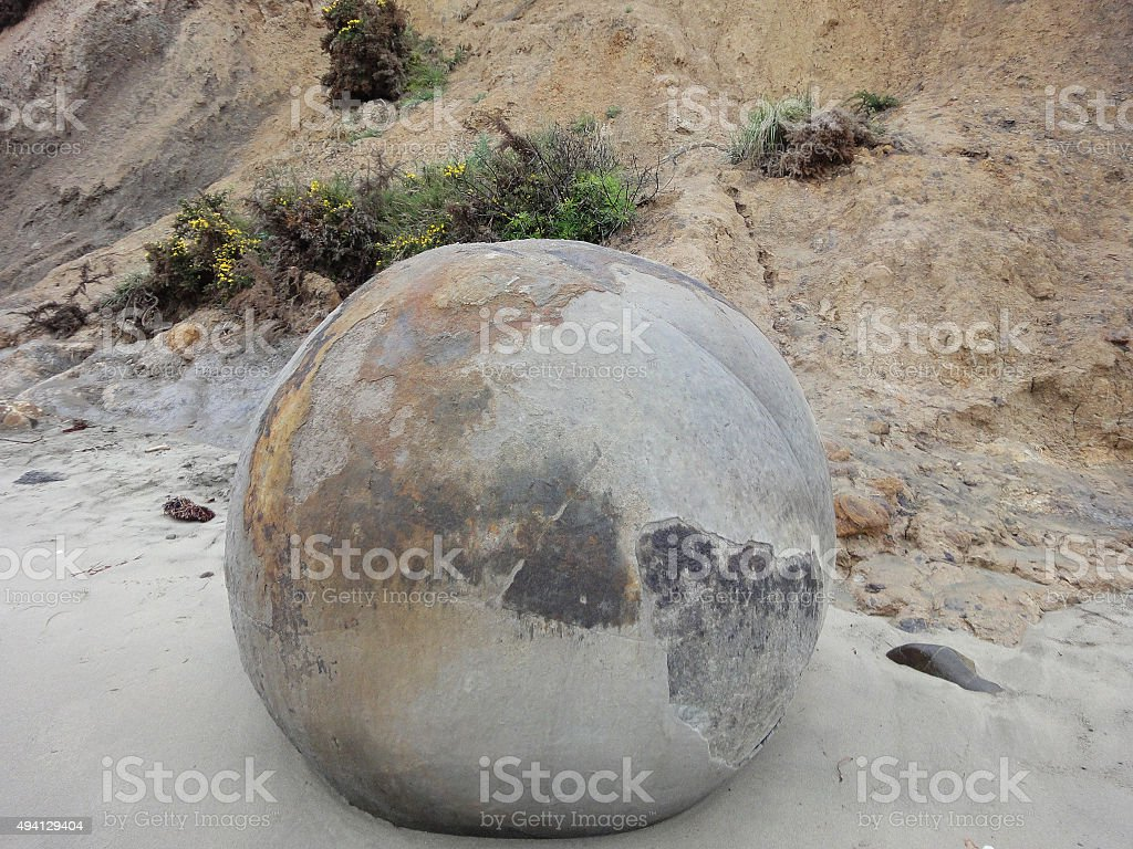 Single Huge Round Boulder on the Beach at Moeraki stock photo