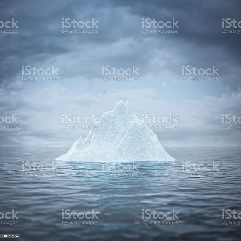 A single iceberg in the middle of the ocean stock photo