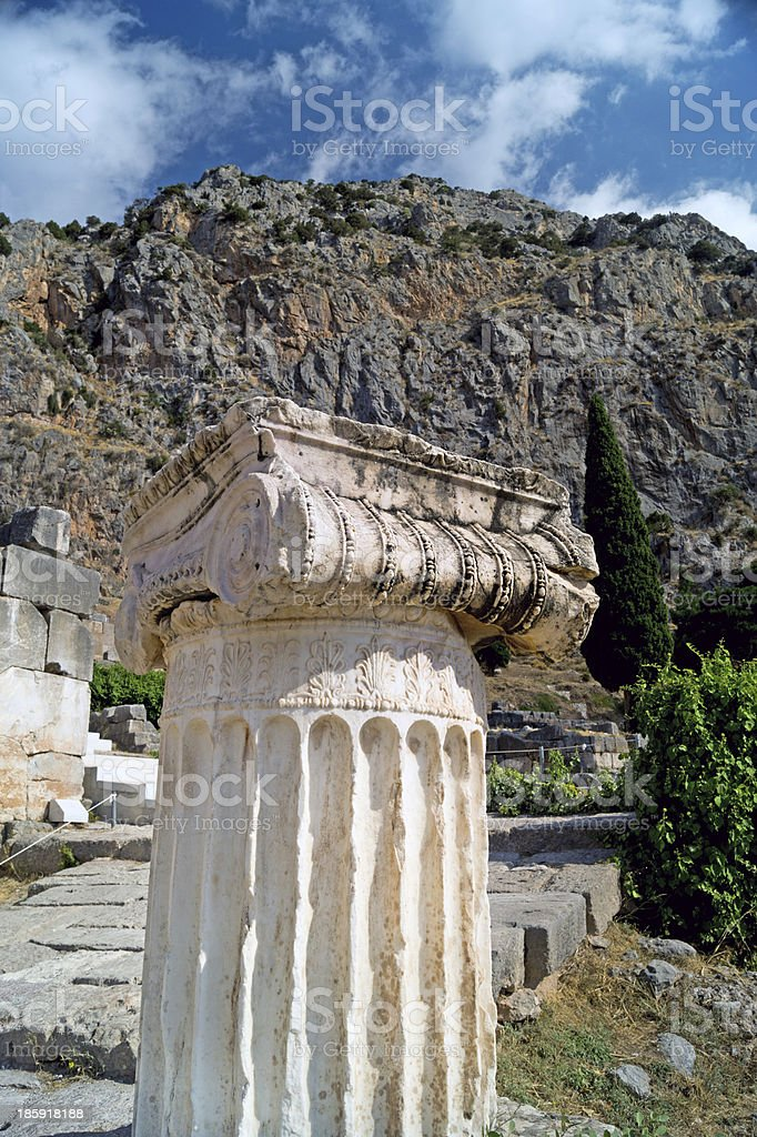 Single ionic order capital at Delphi archaeological site in Gree royalty-free stock photo