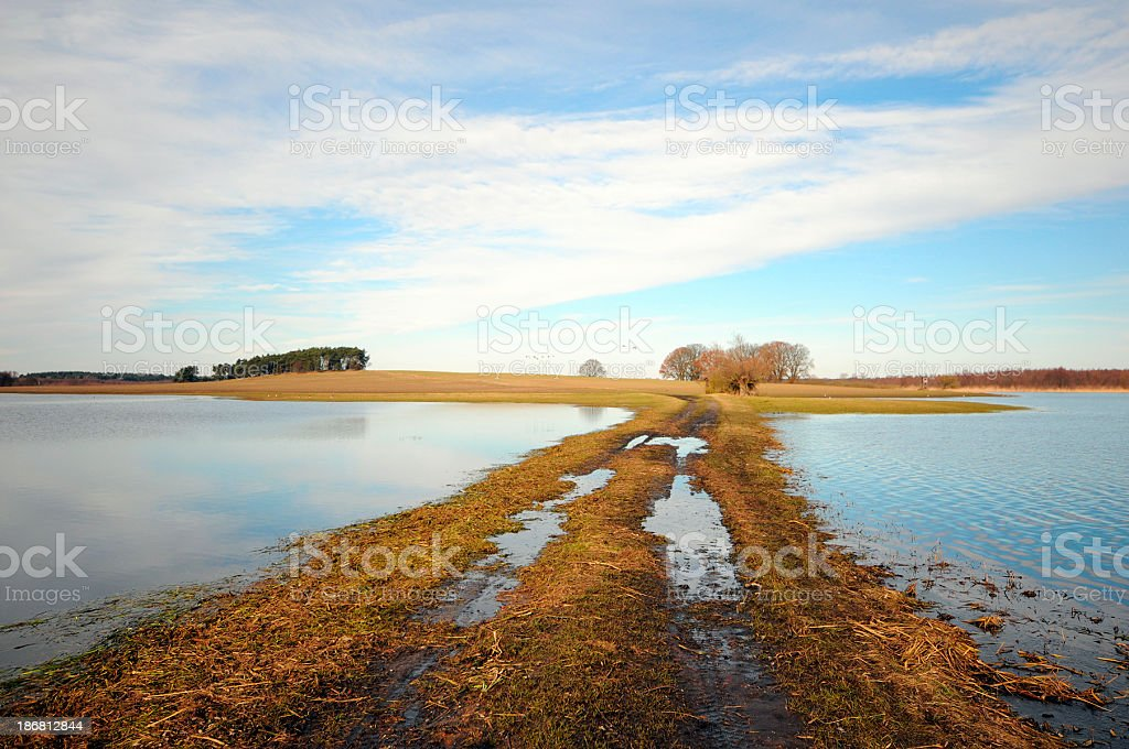 single lane road over flood by water of havel river stock photo