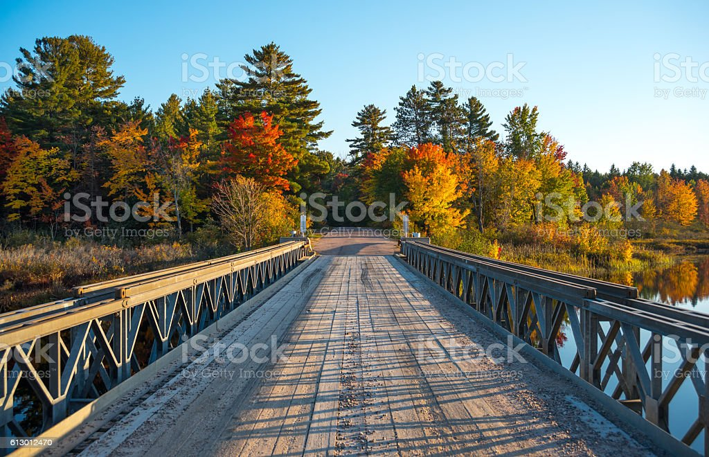 Single lane steel and timber bridge over Corry Lake. stock photo