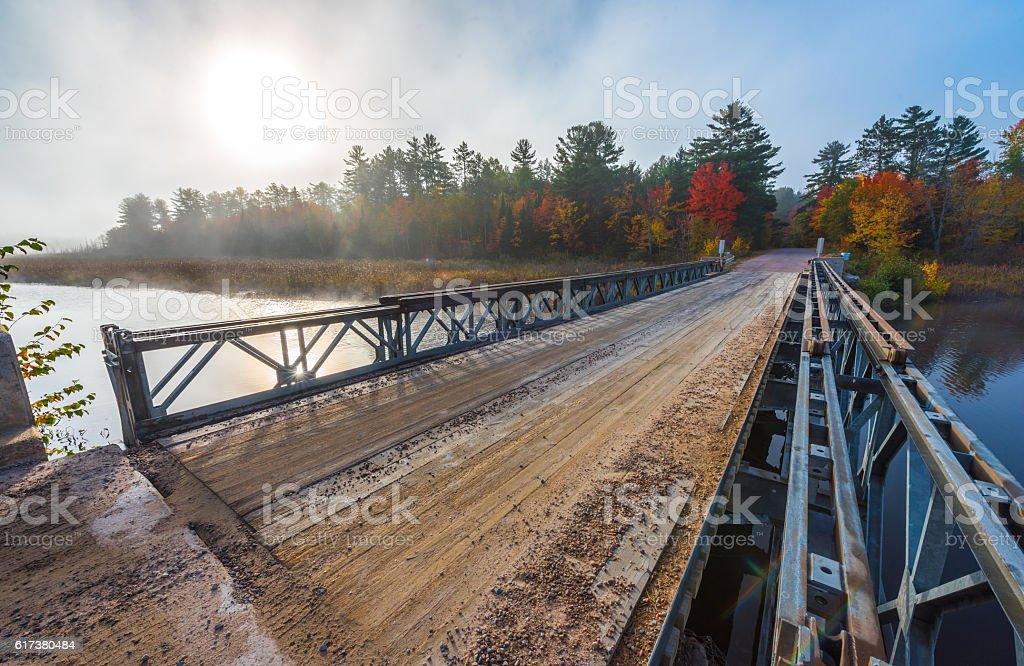 Single lane steel and timber bridge over Corry Lake. stock photo