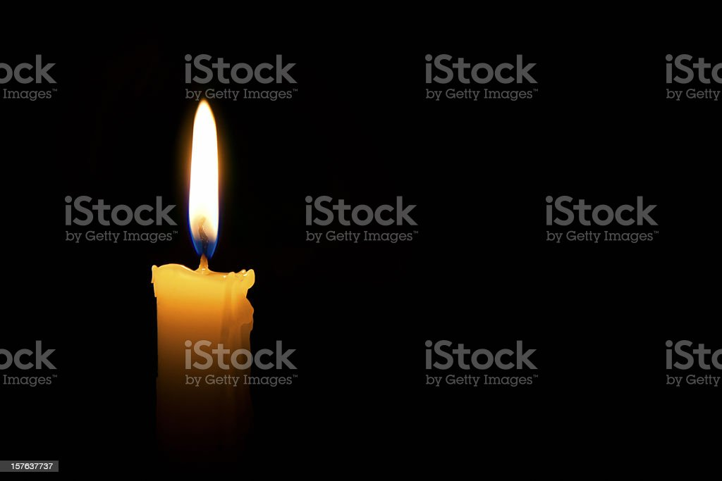 Single lit candle with quite flame stock photo