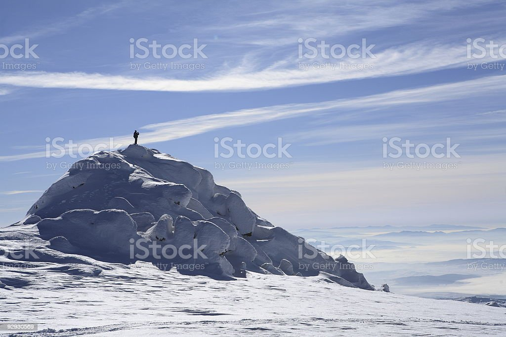 Single man on summit stock photo